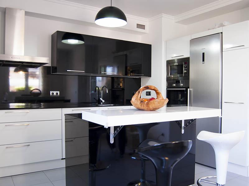 Bienvenidos a dg muebles cocinas i mobiliario de hogar y for Encimera negra brillo
